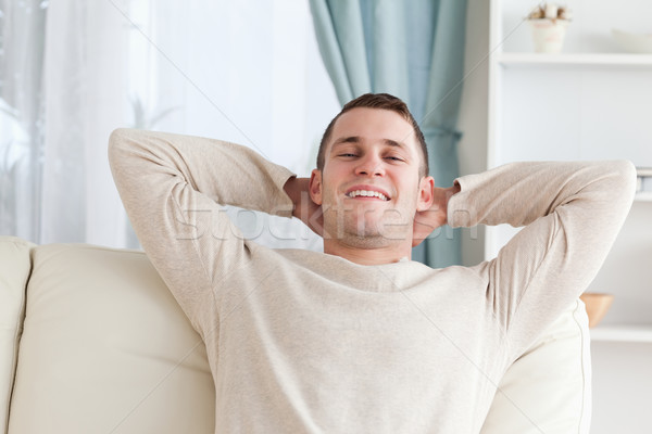 Mann entspannenden Sofa Wohnzimmer Modell home Stock foto © wavebreak_media