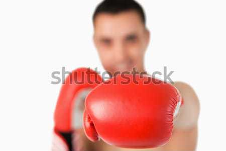 Left fist used to punch by boxer against a white background Stock photo © wavebreak_media
