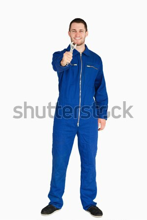 Sorridente jovem mecânico terno brasão dobrado Foto stock © wavebreak_media