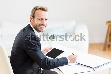 Smiling young businessman tired in his homeoffice Stock photo © wavebreak_media