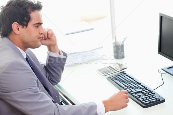 Yandan görünüş genç işadamı oturma büro iş Stok fotoğraf © wavebreak_media