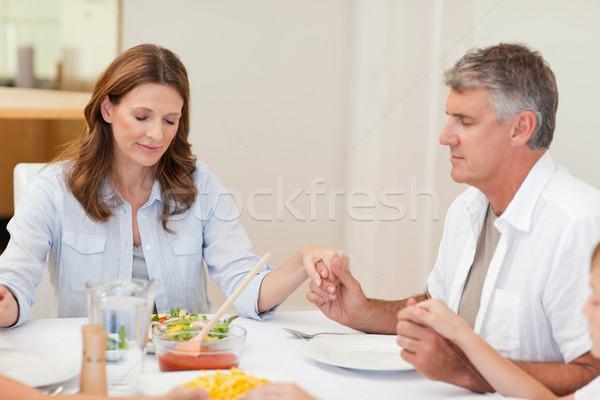 Family praying together before dinner Stock photo © wavebreak_media