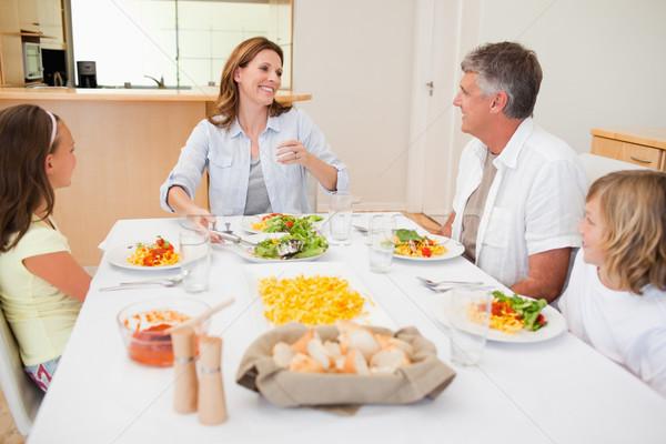Aile birlikte yemek masası gülümseme erkek Stok fotoğraf © wavebreak_media