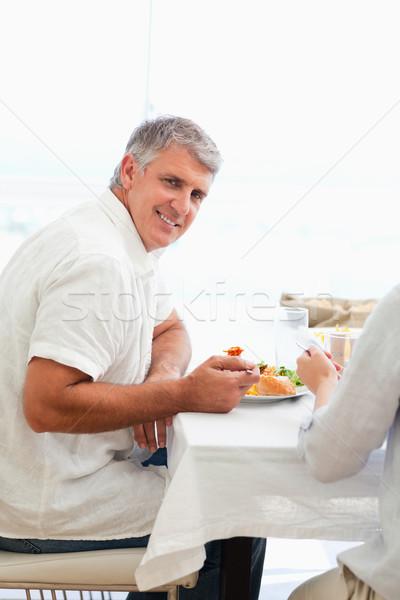 Side view of smiling mature man having dinner Stock photo © wavebreak_media