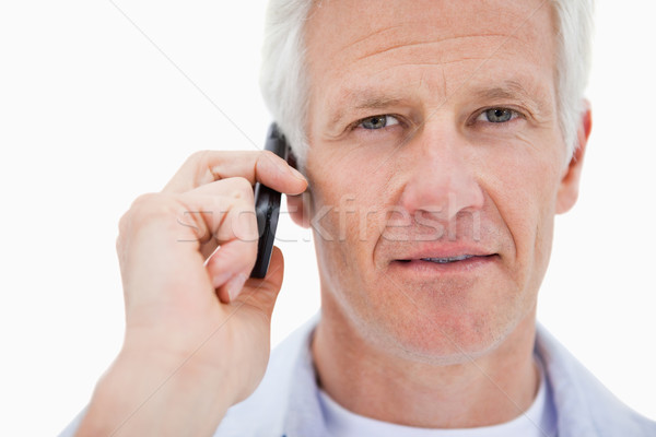 Mature man making a phone call against a white background Stock photo © wavebreak_media