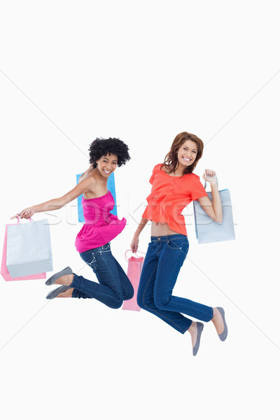 Dynamic teenagers energetically leaping after going shopping Stock photo © wavebreak_media