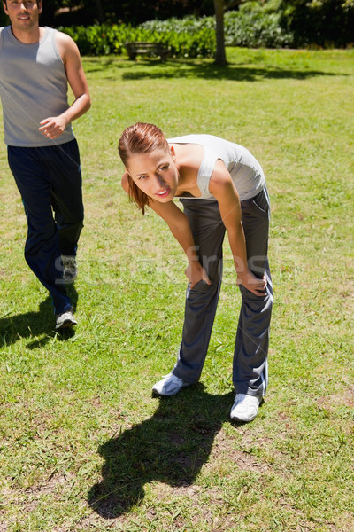 Nő görbület férfi jogging mögött fű Stock fotó © wavebreak_media