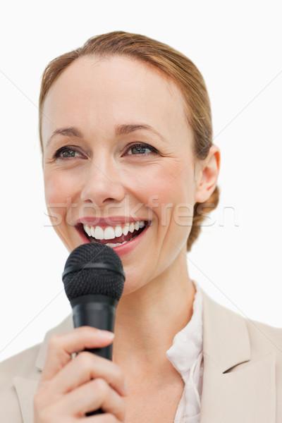 восторженный женщину костюм микрофона белый Сток-фото © wavebreak_media