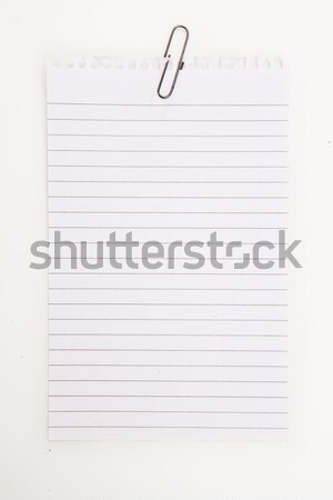 Blank page with red paperclip  against a white background Stock photo © wavebreak_media