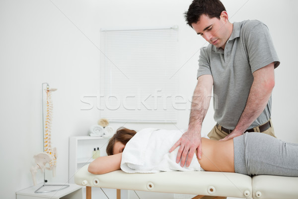 Brown-haired doctor massaging the back of a woman in a room Stock photo © wavebreak_media