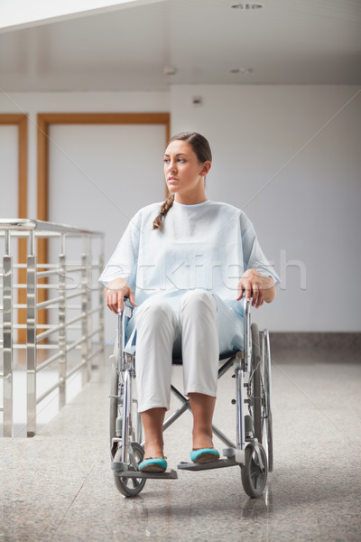 Front view of a thoughtful patient sitting on a wheelchair in hospital hallway Stock photo © wavebreak_media