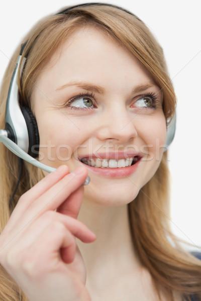 Közelkép nő headset felfelé néz fehér telefon Stock fotó © wavebreak_media