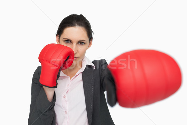 Serious woman wearing red gloves punching against white background Stock photo © wavebreak_media