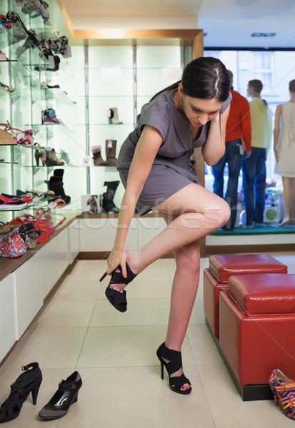 Kobieta stałego boutique buty twarz moda Zdjęcia stock © wavebreak_media
