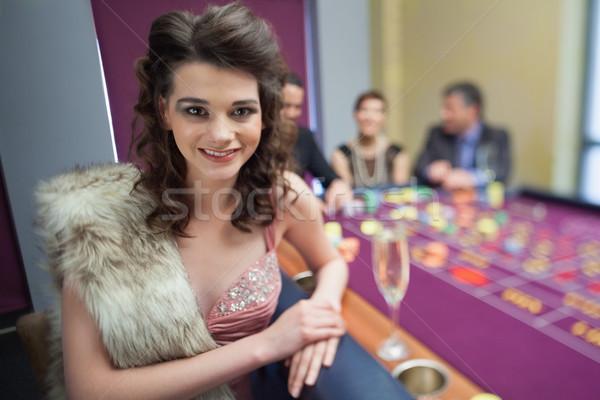 Woman in fur taking break from roulette in casino Stock photo © wavebreak_media