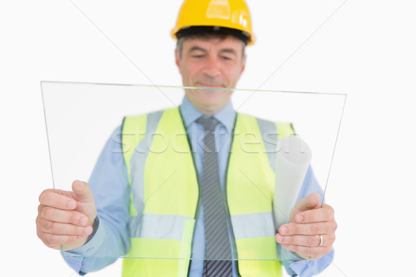 Man holding a huge glass slide while viewing it and smiling Stock photo © wavebreak_media