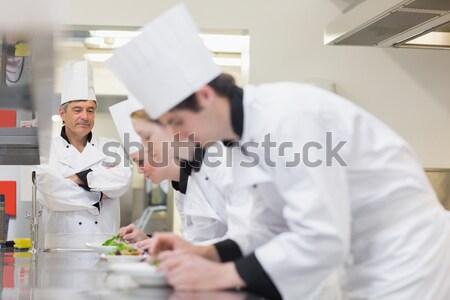 Trainne Chef's preparing salads in class in kitchen Stock photo © wavebreak_media