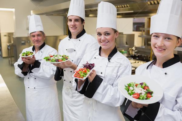 Boldog séfek bemutat konyha étel étterem Stock fotó © wavebreak_media