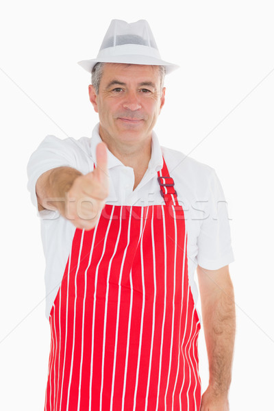 Smiling butcher giving thumbs up Stock photo © wavebreak_media