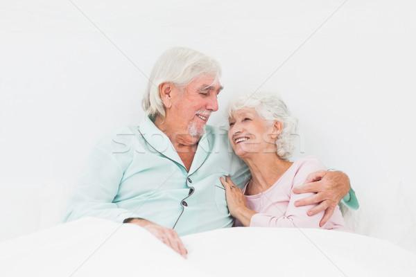 ストックフォト: 高齢者 · カップル · ベッド · 座って · 男 · 幸せ