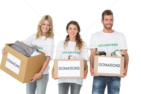 Ritratto tre sorridere giovani donazione scatole Foto d'archivio © wavebreak_media