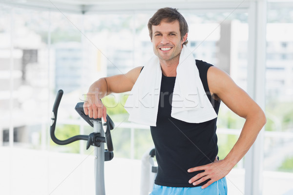Smiling man standing at spinning class in bright gym Stock photo © wavebreak_media