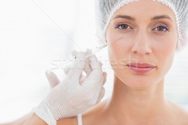 Beautiful woman having botox injection Stock photo © wavebreak_media