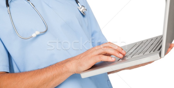 Close-up mid section of a male surgeon using laptop Stock photo © wavebreak_media