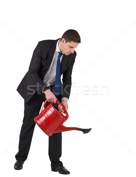 Businessman watering with red can Stock photo © wavebreak_media