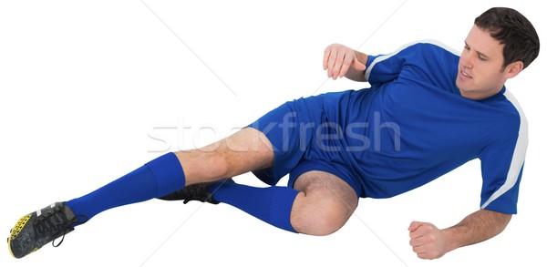 Futballista kék rúg fehér férfi futball Stock fotó © wavebreak_media