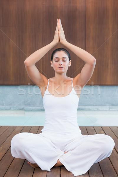 Pacífico mujer blanco sesión loto plantean Foto stock © wavebreak_media