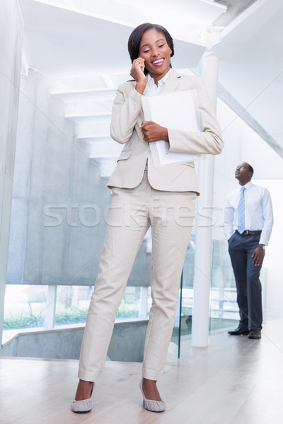 Estate agent talking on phone with buyer in background Stock photo © wavebreak_media