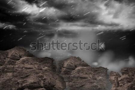 Large rock overlooking snowy sky Stock photo © wavebreak_media