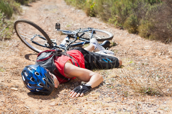 Injured cyclist lying on ground after a crash Stock photo © wavebreak_media