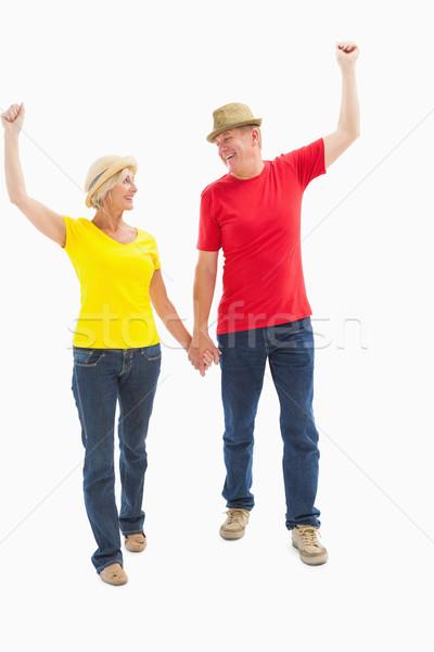 Volwassen paar lopen holding handen witte gelukkig Stockfoto © wavebreak_media