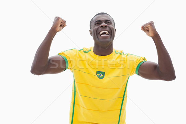 Cheering brazilian football fan in yellow Stock photo © wavebreak_media