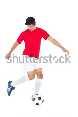Football player in red kicking ball Stock photo © wavebreak_media