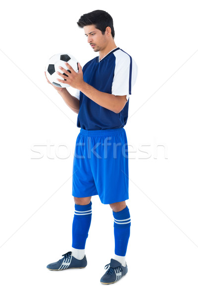 Handsome football player in blue holding the ball Stock photo © wavebreak_media