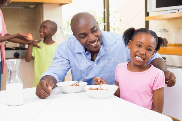 Сток-фото: счастливая · семья · завтрак · вместе · утра · домой · кухне