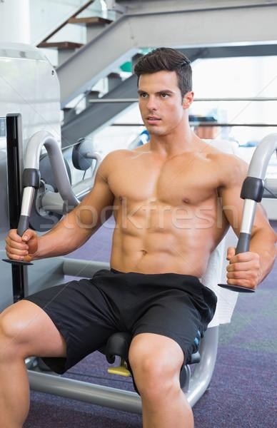 Gespierd man werken abdominaal machine gymnasium Stockfoto © wavebreak_media