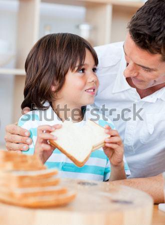 Pediatric dentist showing little girl teeth model Stock photo © wavebreak_media
