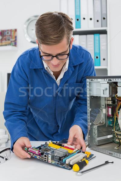 Young technician working on broken cpu Stock photo © wavebreak_media