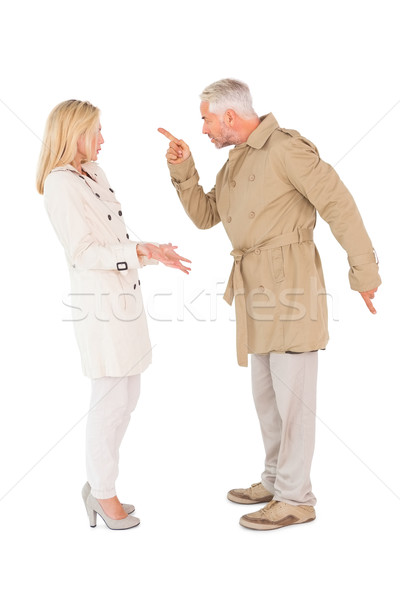 Angry couple fighting in trench coats Stock photo © wavebreak_media