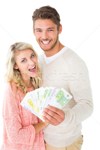 Attractive couple flashing their cash Stock photo © wavebreak_media