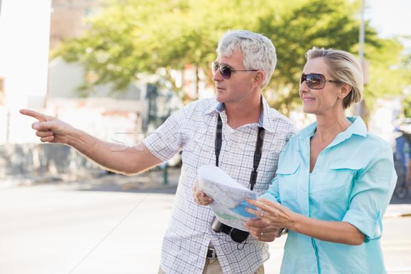 Happy tourist couple using map in the city Stock photo © wavebreak_media