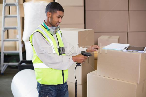 Warehouse worker scanning a box Stock photo © wavebreak_media