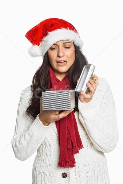 Geschokt vrouw opening christmas aanwezig witte Stockfoto © wavebreak_media