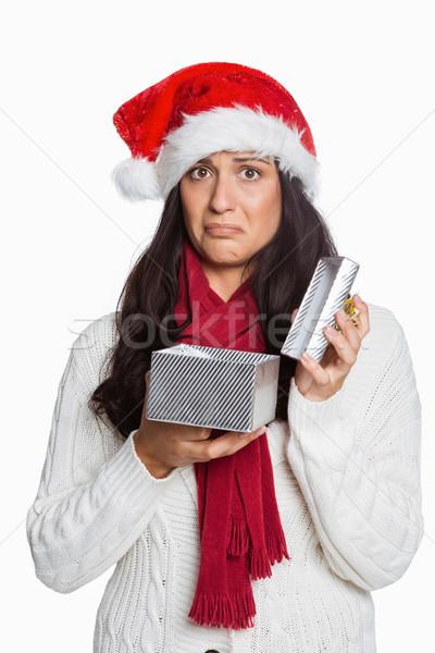Conmocionado mujer apertura Navidad presente blanco Foto stock © wavebreak_media