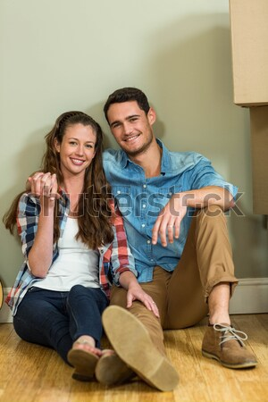 Young couple sitting on floor with tablet Stock photo © wavebreak_media