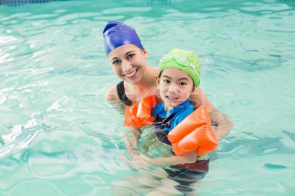 Cute weinig jongen leren zwemmen coach Stockfoto © wavebreak_media